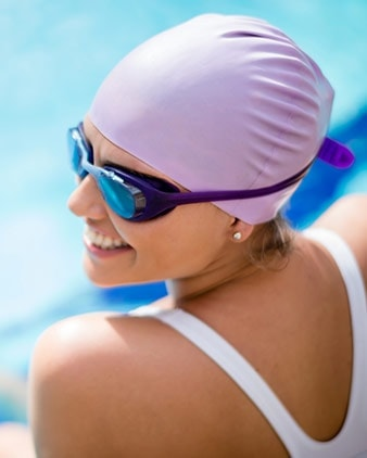 A girl wearing pool glasses