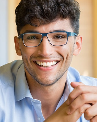 A male student wearing glasses