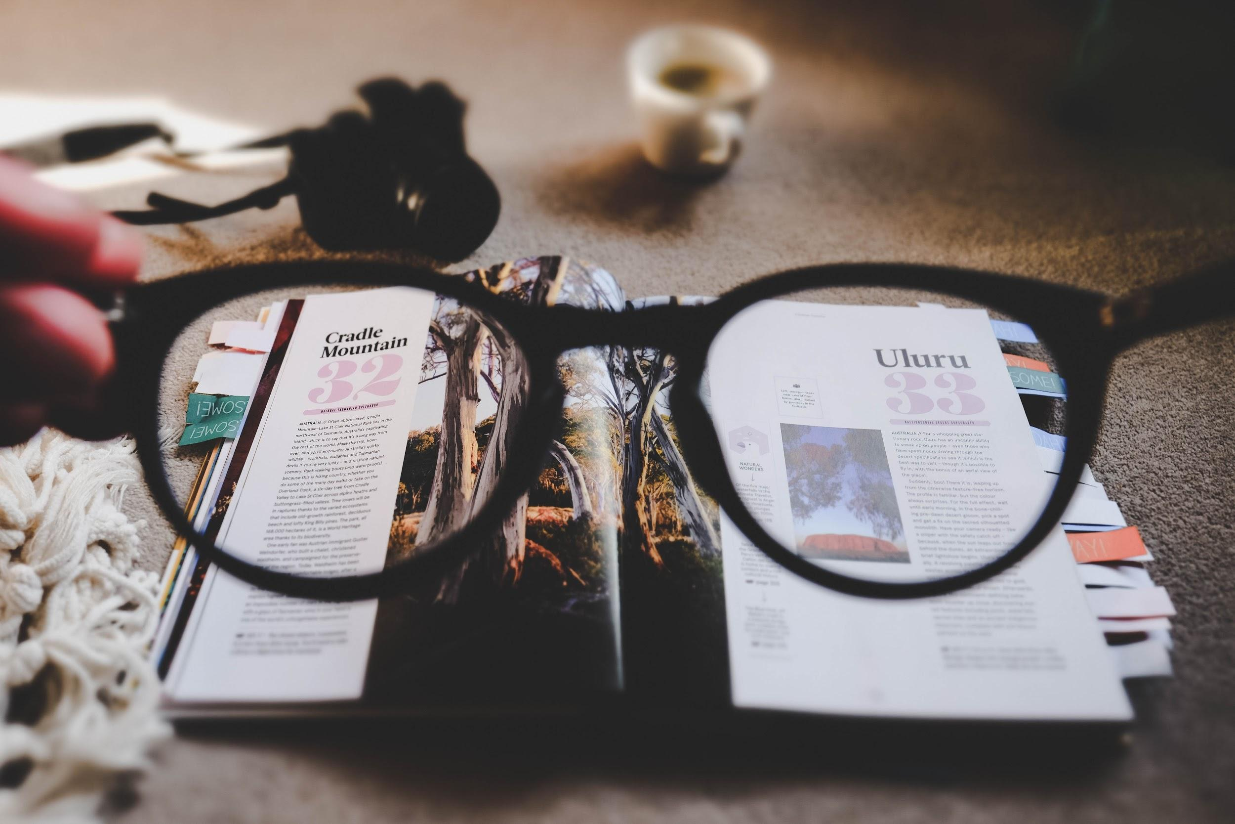 A book in focus through the glasses